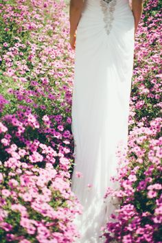 Summer in full bloom provides a simply stunning backdrop for all your wedding photos. This is one of our lovely brides in the walled gardens in July!