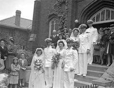 Group weddings were not uncommon during the war, as evidenced by this photograph of a quadruple wedding of four servicemen and their brides. Dated 1943.