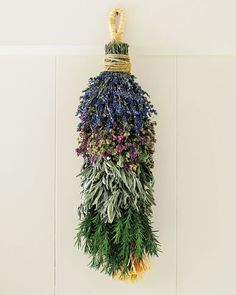 "Hang this swag in the kitchen, then snip off sprigs of preserved lavender, Santa Cruz oregano, sage, rosemary to add to favorite recipes. The herbicide-free and pesticide-free herbs are grown and arranged by hand on a family farm in Monterey, California. Protect from weather. 20"" long. A Williams-Sonoma exclusive."