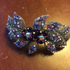 Purple crystal NEVER BEEN USED Great condition, purple crystal hair clip, flower design, it is brand new, bought it for prom but I didn't like the way it looked with my dress! Accessories Hair Accessories