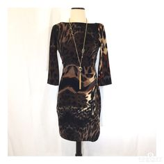 Walk on the wild side! Jessica Simpson dress Stunning Jessica Simpson animal print dress. Polyester and spandex pointe knit. 3/4 sleeves. Some piling. Size 2. 35 inches long. Gorgeous ruched stitching at side. Jessica Simpson Dresses