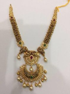 Antique Gold Haram with Peacock Nakshi pendant photo