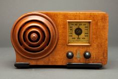 """The impressive design of this 1939 Emerson makes itthemost Machine AgeIngraham cabinet made. The design with it'sincredible protruding """"Bullseye"""" and curved cabinet styling is attributed to designer Alexis de Sakhnoffsky who was responsible for the design of the incredible """"Mae West""""."""