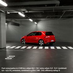 In this photo, the grey and dimly lit parking garage provides a context that emphasizes the striking red paint and dynamic exterior design of the Volkswagen Golf GTI.