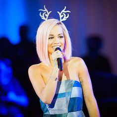 Star Tracks: Tuesday, November 4, 2014 | CHRISTMAS CROONER | Where's Rudolph? British singer Rita Ora performs at the Westfield Shopping Centre in London on Sunday to celebrate the Christmas Lights Switch On ceremony.