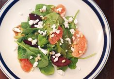 Spinach and beet salad with goat cheese, pine nuts, and grapefruit