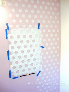 Wall decor DIY for nursery or kid's room. How to paint a polka-dot feature wall! So simple and so sweet for a little girl's room or a nursery! Plus - it's way cheaper than wallpaper! Nursery Room, Girl Nursery, Girls Bedroom, White Nursery, Nursery Ideas, Bedroom Ideas, Master Bedroom, Bedrooms, Little Girl Rooms