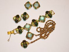 Green Art Glass Parure by LustfulJewels on Etsy We have no idea who made this! We have been told it is Schiaparelli, Kafin, Henkel & Grosse, Barclay and the list goes on! We really hope someone at some point can identify it.