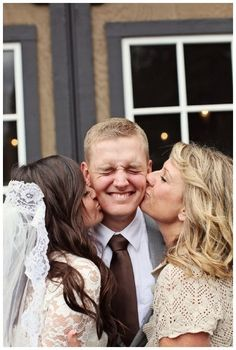 bride and mother of the groom = must have picture. too sweet! Also a must have a picture of our daughter and I kissing him like this