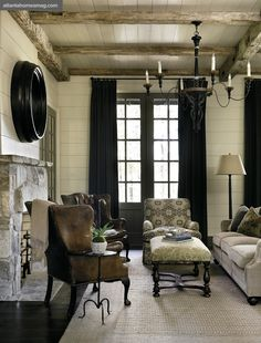 Country Chic ::   Architect D. Stanley Dixon and designer Nancy Warren create a new vision of refined rustic living - love the ceiling treatment - the black curtians would tie in the back weights and balance out the heavy wall plaque behing the weights (would have to do different blinds!)