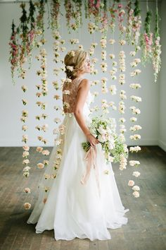 Floral backdrop, photo by Lindsey Orton Photography. Ruffled – photo by http://lindseyortonphotography.com/ – http://ruffledblog.com/romantic-bridal-inspiration-shoot/