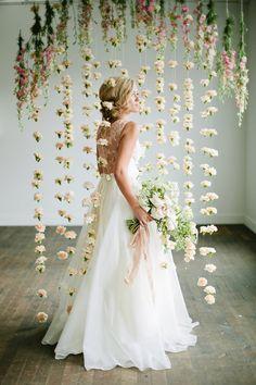 Floral backdrop, photo by Lindsey Orton Photography. Ruffled – photo by http://lindseyortonphotography.com/ – http://ruffledblog.com/romantic-bridal-inspiration-shoot/