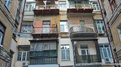 This apartment complex is over 100 years old. Every resident has a different exterior taste.