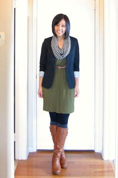 Winter dress layering: brown boots, black leggings, green dress, blue blazer, striped infinity scarf