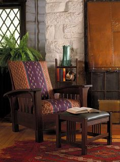 An original Gustav Stickley Morris chair in fumed oak at the Stickley Museum at Craftsman Farms.