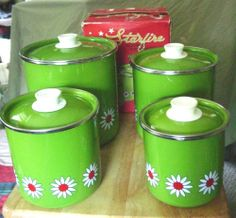 A really great set of vintage 4 Pc. green with a white daisy..;Mid-Century Daisy Canister Set... Starfire Porcelain Green Enamelware.... with their original box...
