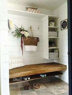 Mudroom bench and hall tree with shiplap, cubbies, floating ledge, and stone tile. Wire baskets in the cube shelves and a straw bag hanging from the hook. Very farmhouse! Cottage style, beach house, breezy and charming.