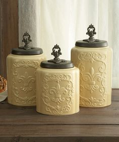 Neaten up the kitchen and add a decorative accent with the beautiful American Atelier Antique Canister Set. The earthenware canisters feature a Fleur-de-Lis on the front with a metal lid to keep your kitchen items fresh. Parisian Kitchen, Tuscan Kitchen Decor, French Country Kitchen Decor, Tuscan Bathroom Decor, Tidy Kitchen, Kitchen Items, Kitchen Storage, Kitchen Things, Kitchen Stuff