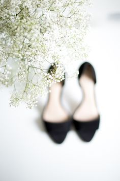 My favorite shoe brand: Loeffler Randall! Black heeled sandals and white flowers.