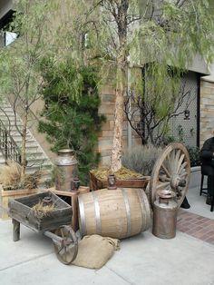Rustic decor. Inspiration for a project, barrel ornament, milk jug ornament, wheelbarrow....