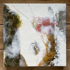 """Original encaustic painting by Tamara Lepianka. Encaustic and mixed media on wood panel with a 1.5"""" cradle. The edges are finished in a light brown pigmented shellac as shown. The painting is wired and ready to hang. 18 x 18 x 1.5 in 