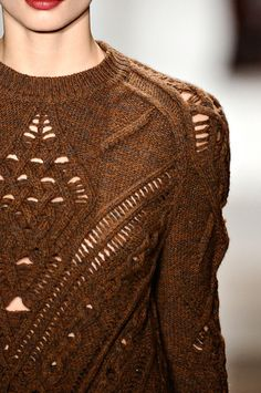 start with two cables and keep adding to the middle and binding off the sides.... for V shape. ALTUZARRA FW2011