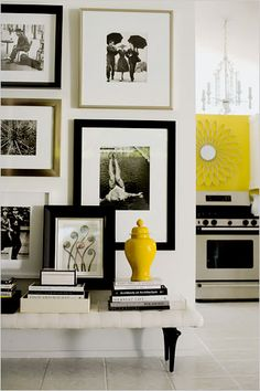 --overlap picture frames on wall so that some stick out Chic Gallery Wall with lovely bench stacked with books.great idea for an entryway or Hallway or focal wall in living room. Estilo Interior, Home Interior, Interior And Exterior, Interior Decorating, Yellow Interior, Bathroom Interior, Modern Bathroom, Decoration Inspiration, Interior Inspiration