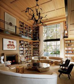 In the double-height library of Eugenio López's Mexico City house, designer Luis Bustamante installed a sculptural Hervé Van der Straeten light fixture. - photo: Ricardo Labougle