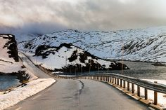 Mountain pass leads through the snow covered mountain tops between  Vik and Voss in Norway. Photo: John & Tina Reid