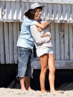 Selena Gomez being hugged by Justin Bieber at a Malibu beach on September 23, 2011.