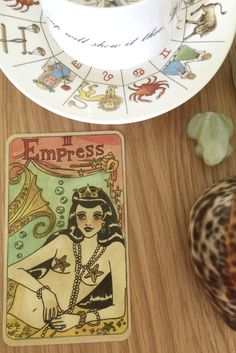 Tarot Fortune teller meanings for the major arcana empress card. Deck in image is from the same Darcy mermaids tarot, with ocean magic art. Tool is on witches altar with gypsy fortune telling astrology style tea cup. - divination and fortune telling Tarot Card Meanings Pdf, Mermaid Tarot, Cup Tattoo, Rider Waite Tarot, Love Tarot, Card Deck, Fortune Telling, The Empress, Tarot Readers