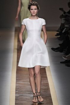 Valentino. I love the notion of a short dress rather than a to-the-floor gown.