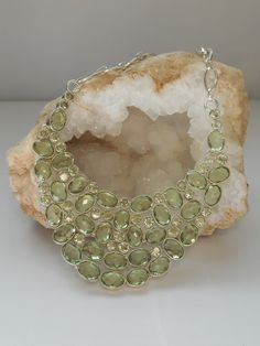 """Beautiful faceted oval and round brilliant shaped green amethyst gemstones in a gorgeous hand made clustered collar, set in 925-hallmarked sterling silver. Length: 16-22""""+ Adjustable toggle clasp. Lar"""