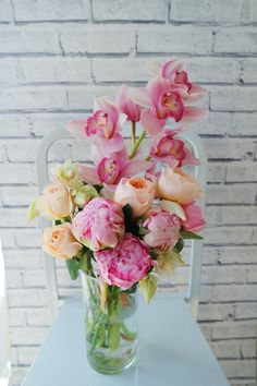 Cymbidium orchid, David Austin roses, blushing bride and peonies