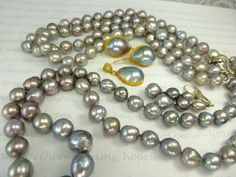 Sea of Cortez pearls, Darker, shorter strand is 23 inches, pearls 11.5-8mm, longer, lighter colored strand, 31 inches, 10-8.5mm from Care Ehret.  Mabes earrings.