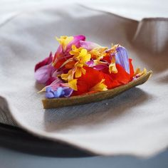 Flower tart from an epic lunch @nomacph today. A little influence from the stay in Japan with the delicate roasted kelp tart shell. There's gooseberries sea buckthorn and thyme on the base topped with gorgeous Danish wild flowers. There's also a spritz of quince aquavit and rose pollen. What a stunner. by insatiableeater