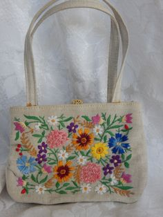 My new purse! :D   Beautiful vintage Walborg purse / handbag. Delicately embroidered with a floral design, on a tan canvas like material. Detailed with a large ornate gold clasp, inside pockets and a footed base. Label reads Made in West Germany Exclusively For Walborg. Dates between the 40's to 60's.