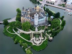 Schwerin Castle, Germany - located in the city of Schwerin, the capital of the Mecklenburg-Vorpommern. Located on an island, charmingly situated in a picturesque landscape of lakes and parkland, Schloss Schwerin is regarded as one of the most beautiful and most important buildings of Romantic Historicism in Northern Europe.