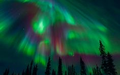Northern lights  - The colour of the aurora depends on which atom is struck, and the altitude of the meeting. Green and reds are found at higher altitudes - while blue, purple and violets are lower.