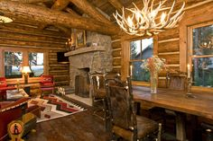: Old Fashioned Rustic Themed Living And Dining Room Interior With Full Of Timber Brightened By Antler Chandelier