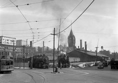 Looking east toward the Milwaukee Road depot. North Shore streetcar on the left.
