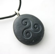Triple Spiral Engraved Stone Female Power Celtic Symbol Grey Stone Necklace. $20.00, via Etsy.
