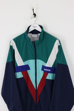 "Very good condition, vintage Adidas shell suit jacket. Measurements: Pit to pit - 29"" Length on back - 31"" Vintage items will usually show a few signs of wear"