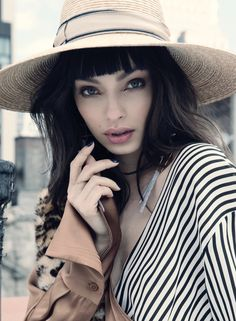 Getting her closeup, Luma Grothe models wide-brimmed hat with bangs