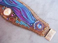 """Passion"" cuff bracelet  - bead embroidered with shibori ribbon embellishment, by RidgwaysSK on Etsy."