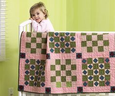 Vintage Baby Quilt - Make this crib quilt in no time with quick strip piecing and rotary cutting techniques. Light pink fabric mixed with subdued greens and blues gives this quilt a vintage feel.  Get instructions for the vintage baby quilt.
