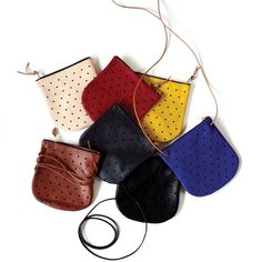 Leather Convertible Dot Pouches by Pine & Boon. You can use as a crossbody for your essentials or as a clutch. Perfect for going out or a date night.
