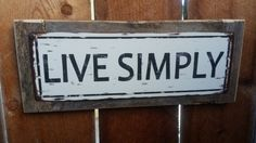 Recycled wood framed Live Simply street sign