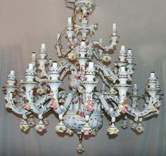 Love, love, love the Capo Di Monte chandeliers