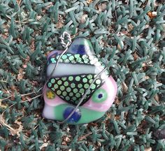 large fused glass wire wrapped pendant by PiecesofhomeMosaics.etsy.com